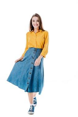 Full length view of smiling attractive girl holding denim skirt isolated on white stock vector