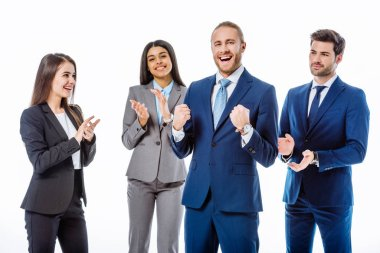 multicultural business people in suits applauding happy businessman showing yeah gesture isolated on white