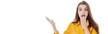 shocked attractive girl with open mouth pointing with hand isolated on white, panoramic shot