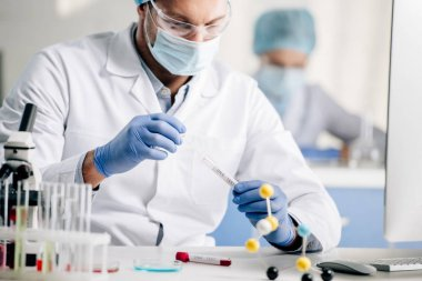 selective focus of genetic consultant doing dna test in lab
