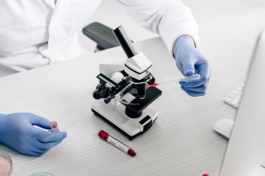 Cropped view of genetic consultant doing dna test in lab stock vector
