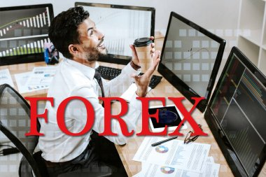 Happy bi-racial trader holding paper cup and sitting near computers and forex letters stock vector