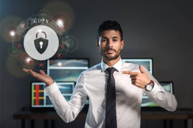 Bi-racial trader pointing with finger at gdpr letters near padlock stock vector