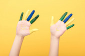 cropped view of woman with colorful fingers isolated on yellow