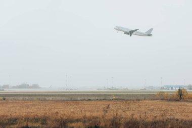 Departure of commercial plane on airport runway stock vector