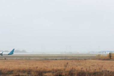 Flight departure of commercial plane on airport runway stock vector