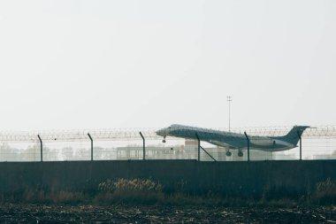 Departure of jet plane from airport runway stock vector