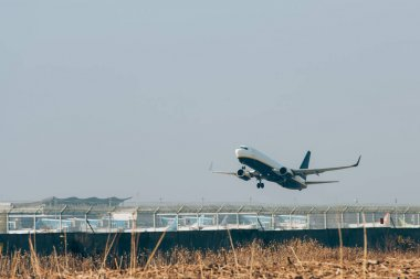 Flight departure of airplane on airport runway stock vector