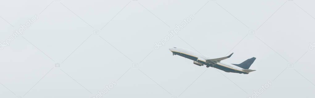 Panoramic shot of commercial jet in cloudy sky stock vector