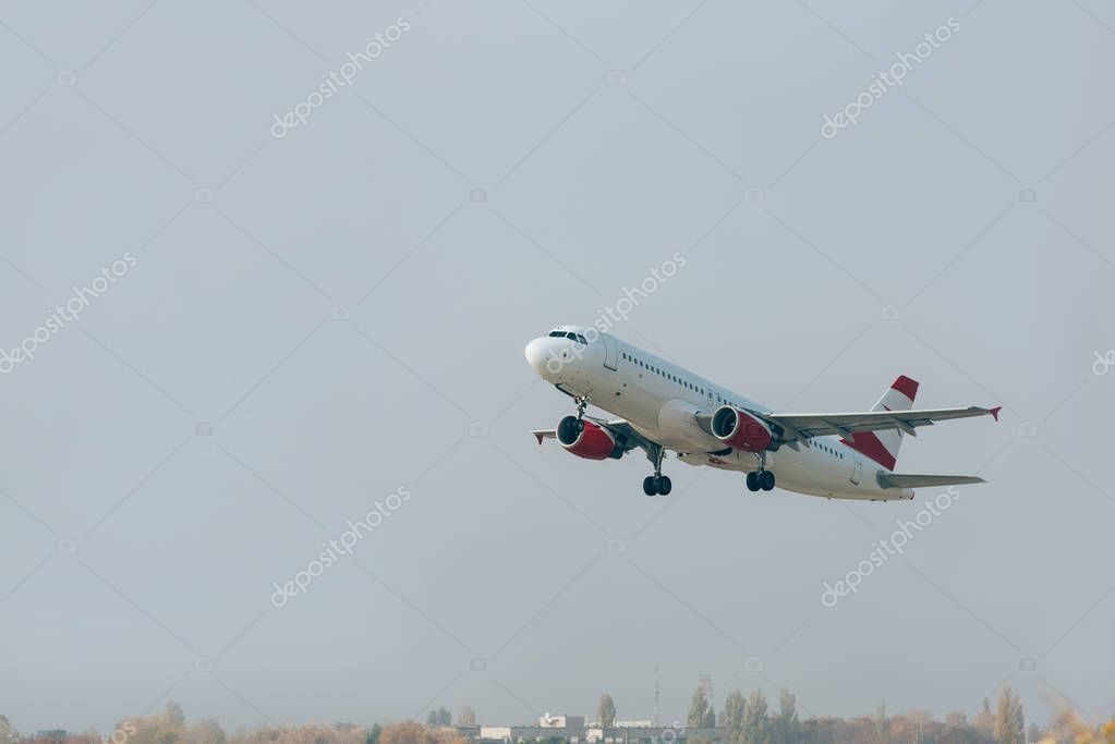 Airplane departure from airport runway with cloudy sky at background stock vector