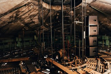 Technical constructions with ladders and speakers in circus warehouse