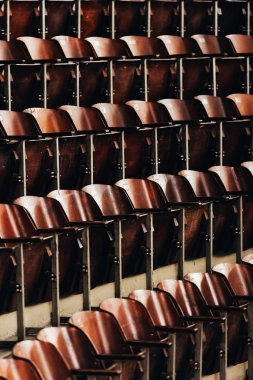Selective focus of rows of empty wooden seats in circus stock vector