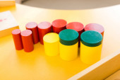 Selective focus of colorful wooden board game on table in class
