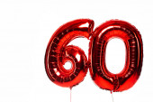 number 60 red balloons isolated on white