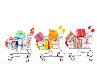 Decorative small shopping carts with gift boxes isolated on white stock vector