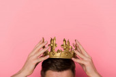 cropped view of man wearing crown on pink background