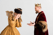 queen and king with crowns quarreling isolated on grey