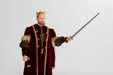 king with crown holding sword isolated on grey