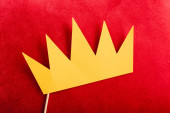 top view of paper crown on red pillow