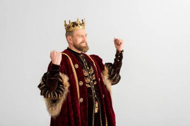 happy king with crown showing yes gesture isolated on grey