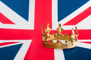 golden crown on british flag with copy space