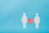 top view of paper cut figures of homosexual couple with heart isolated on blue, sexual equality concept