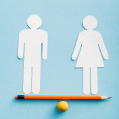 paper cut figures of couple as gender equality on pencil with small ball isolated on blue, sexual equality concept