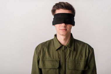 young blindfolded man isolated on white, human rights concept