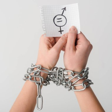 Cropped view of woman in chains holding paper with gender symbol isolated on white, sexual equality concept stock vector