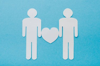 Top view of paper cut figures of homosexual couple isolated on blue, human rights concept stock vector
