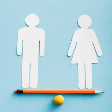 Paper cut figures of couple as gender equality on pencil with small ball isolated on blue, sexual equality concept stock vector