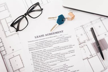 Top view of document with lease agreement lettering near glasses, blueprints and keys on desk stock vector