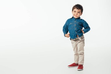 Smiling boy in denim shirt looking at camera on white background stock vector
