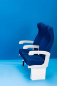 Photo bright and colorful seats on blue background with copy space