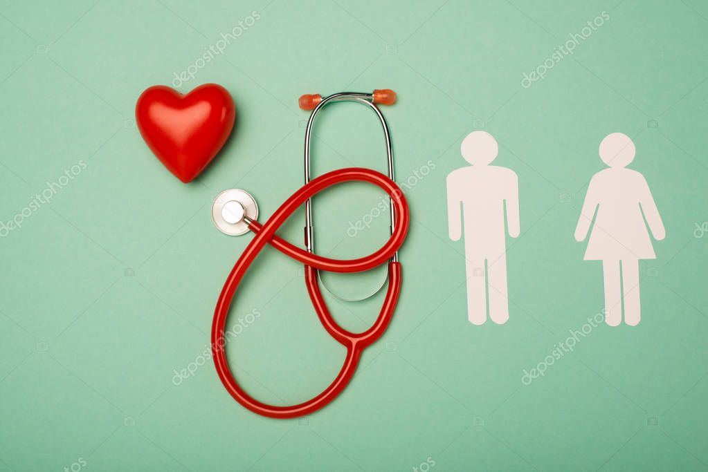 Top view of stethoscope, decorative heart with male and female symbols on green background, world health day concept stock vector