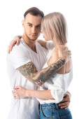 Fényképek sexy young tattooed couple hugging isolated on white