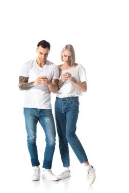Young tattooed couple using smartphones isolated on white stock vector