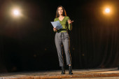 Photo attractive young actress reading scenario on stage in theatre