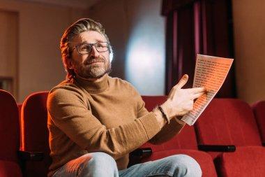 Emotional stage director showing scenario in theater stock vector