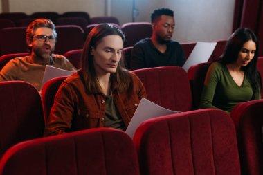 Multiethnic actors and actress reading scripts in theatre stock vector