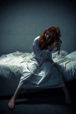 Female demon in nightgown shouting in bedroom stock vector