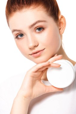 Attractive teen girl with perfect skin holding plastic container with cosmetic cream, isolated on white stock vector