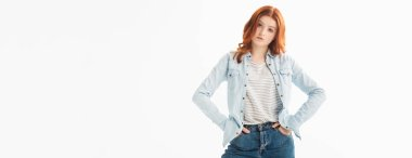 Panoramic shot of redhead teenager in denim clothes with akimbo gesture, isolated on white stock vector