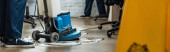 cropped view of cleaner washing floor with cleaning machine, panoramic shot