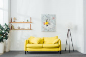 Interior of living room with yellow sofa and floor lamp