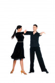 elegant young couple of ballroom dancers in black dress and suit dancing isolated on white