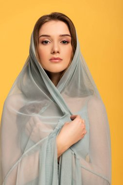 Beautiful elegant girl in silk veil isolated on yellow stock vector