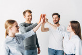 Young coworkers high five and smiling in office