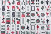 KYIV, UKRAINE - JANUÁR 30, 2019: mező mahjong játék csempe jelek és karakterek, felső nézet