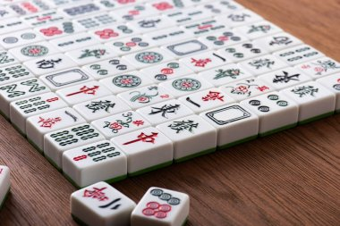 KYIV, UKRAINE - JANUARY 30, 2019: field of white mahjong game tiles on wooden table stock vector